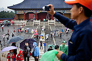"""Visitors and tourist photographing at """"The Temple of Heaven"""" which is a complex of Taoist buildings situated in the southeastern part of central Beijing. Beijing is the capital of the People's Republic of China and one of the most populous cities in the world with a population of 19,612,368 as of 2010."""