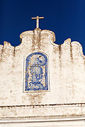 Historic church inside the walled hilltop village of Marvao, Alto Alentejo, Portugal, Azulejo detail on whitewashed wall deep blue sky