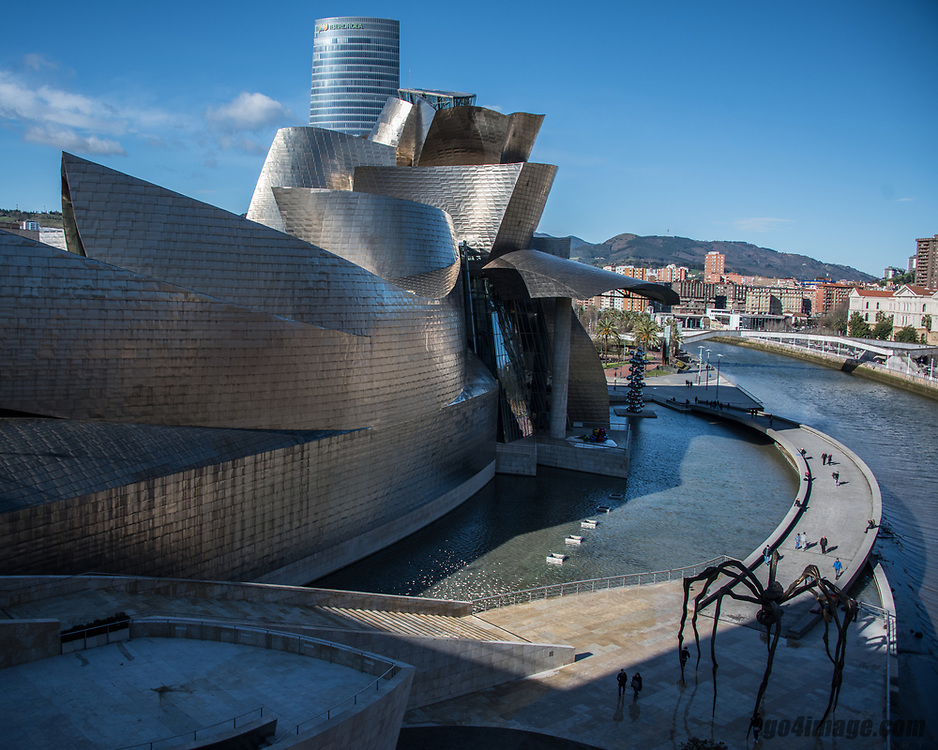 Spain Bilbao March 2018. <br /> Guggenheim Museum Bilbao.<br /> Designed by American architect Frank Gehry, the Guggenheim Museum Bilbao building represents a magnificent example of the most groundbreaking 20th-century architecture. With 24,000 m2, of which 11,000 are dedicated to exhibition space, the Museum represents an architectural landmark of audacious configuration and innovating design, providing a seductive backdrop for the art exhibited in it.
