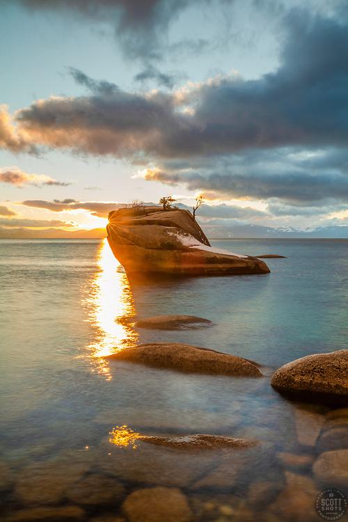 """Bonsai Rock Sunset 10"" - Photograph of a sunburst from the setting sun at Bonsai Rock on the east shore of Lake Tahoe."