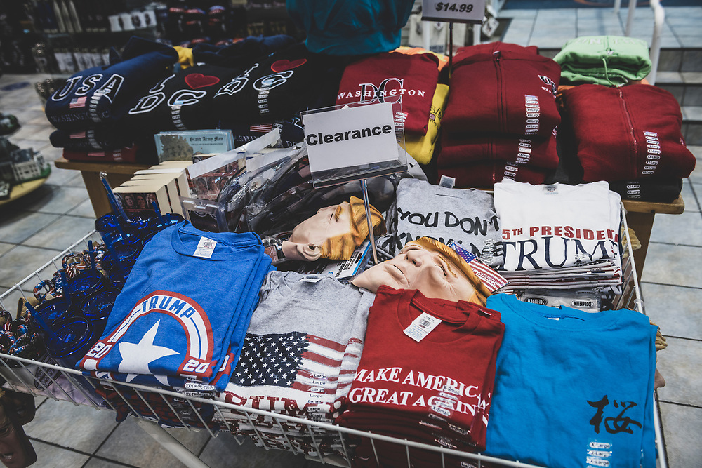 Washington DC, USA - January 22, 2021: Two days after the Biden Inauguration, Donald Trump t-shirts and face masks sit in a clearance section of a store specializing in political souvenirs.