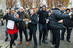 © Licensed to London News Pictures. 08/11/2020. Manchester , UK. Protesters shout at police . Police move to break up an anti lockdown protest in Piccadilly Gardens in Manchester City Centre , after issuing a dispersal order to those at the demo . Photo credit: Joel Goodman/LNP