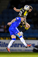 Gillingham FC midfielder Mark Byrne (33) and Rotherham United midfielder Jon Taylor (11)  during the EFL Sky Bet League 1 match between Gillingham and Rotherham United at the MEMS Priestfield Stadium, Gillingham, England on 17 April 2018. Picture by Martin Cole.