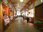 Market stalls inside historic market building in Triana, city of Seville, Spain