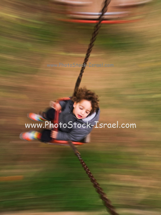 Toddler on a swing. Camera Panning Technic