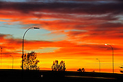 Blazing sky at sunrise on Trans Canada Highway<br /> Swift Current<br /> Saskatchewan<br /> Canada