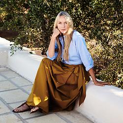 Collette Dinnigan, posing in her villa's garden. Ostuni, Italia. September 28, 2019.