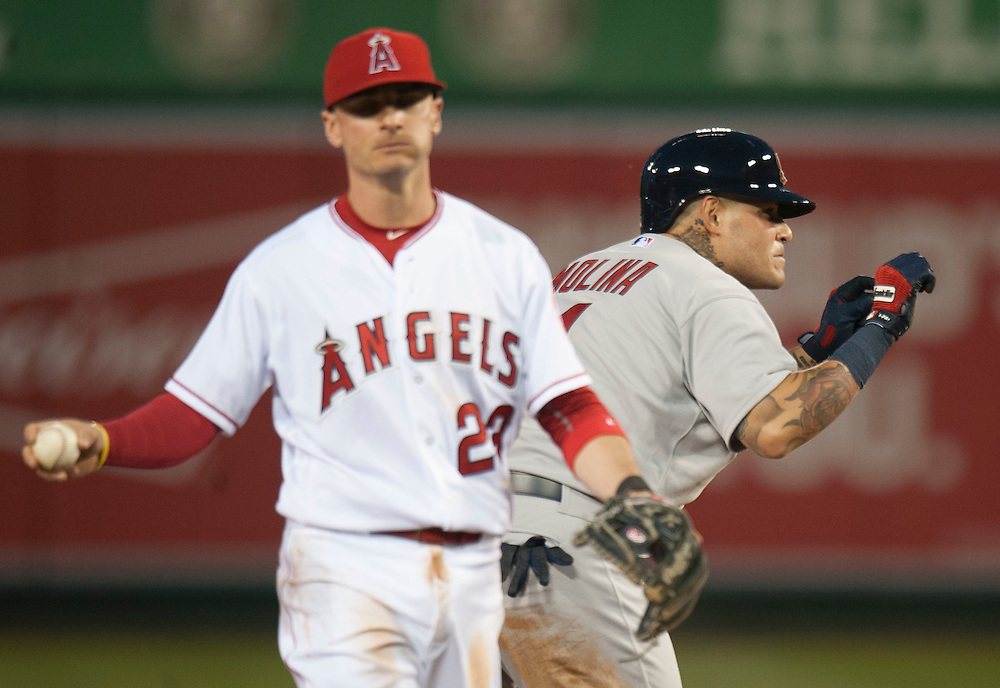 The Cardinals' Yadier Molina celebrates a double past the Angels' Brendan Ryan in the third inning Wednesday night at Angel Stadium.<br /> <br /> ///ADDITIONAL INFO:   <br /> <br /> angels.0512.kjs  ---  Photo by KEVIN SULLIVAN / Orange County Register  --  5/11/16<br /> <br /> The Los Angeles Angels take on the St. Louis Cardinals at Angel Stadium Wednesday.<br /> <br />  5/11/16