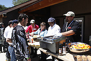 CHef serving food at 2010 Rawhyde Adventure Rider Challenge