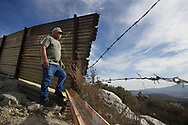 """Mountain Minuteman Robert """"Lil Dog"""" Crooks stands patrol at Patriot Point along the U.S.-Mexico border in Campo, California on Saturday, November 17, 2018 in Campo California.  Crooks, who has been on look-out at the border for over Ten Years, alerts Border Patrol agents to illegal or suspicious activity."""