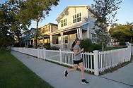 A jogger runs past a row of homes in the Mills 50 district of Orlando, Fla., Monday, Oct. 17, 2016. (Phelan M. Ebenhack via AP)