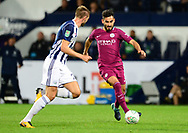 Ilkay Gundogan of Manchester City ® in action with Gareth McAuley of West Bromwich Albion .Carabao Cup 3rd round match, West Bromwich Albion v Manchester City at the Hawthorns stadium in West Bromwich, Midlands on Wednesday 20th September 2017. pic by Bradley Collyer, Andrew Orchard sports photography.