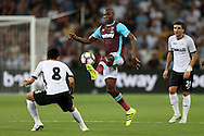 Angelo Ogbonna Obinze of West Ham United © attempts a chip over Takayuki Seto of Astra Giurgiu. UEFA Europa league, 1st play off round match, 2nd leg, West Ham Utd v Astra Giurgiu at the London Stadium, Queen Elizabeth Olympic Park in London on Thursday 25th August 2016.<br /> pic by John Patrick Fletcher, Andrew Orchard sports photography.