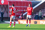 Ethan Pinnock of Barnsley (5) urges his team mates during the EFL Sky Bet League 1 match between Barnsley and Coventry City at Oakwell, Barnsley, England on 30 March 2019.