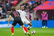 Fabian Delphi (England) clears the ball past Luka Modrić (Capt) (Croatia) during the UEFA Nations League match between England and Croatia at Wembley Stadium, London, England on 18 November 2018.
