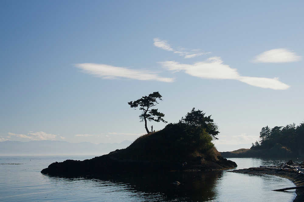 North America, United States, Washington, San Juan Islands,person on island with binoculars