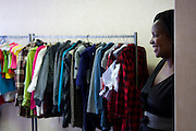 Moyahabo is selecting the dresses to send to China and be re-produced. Moyahabo set up her company that import clothes from China and sold them to the shops of Johannesburg.