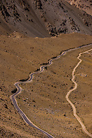 Road leading to Khardungla Pass. At 18,379 feet, the pass is the highest motorable road in the world. Ladakh, Jammu and Kashmir State, India.