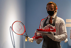 © Licensed to London News Pictures. 21/06/2021. London, UK. Roger Federer's champion outfit, racquet and sneakers from the David Cup 2014 with an estimate of  £20,000,30,000 is on display as part of the Roger Federer Collection at Christies Auction House. Proceed from the evening and online sale will benefit the RF Foundation. Photo credit: Ray Tang/LNP