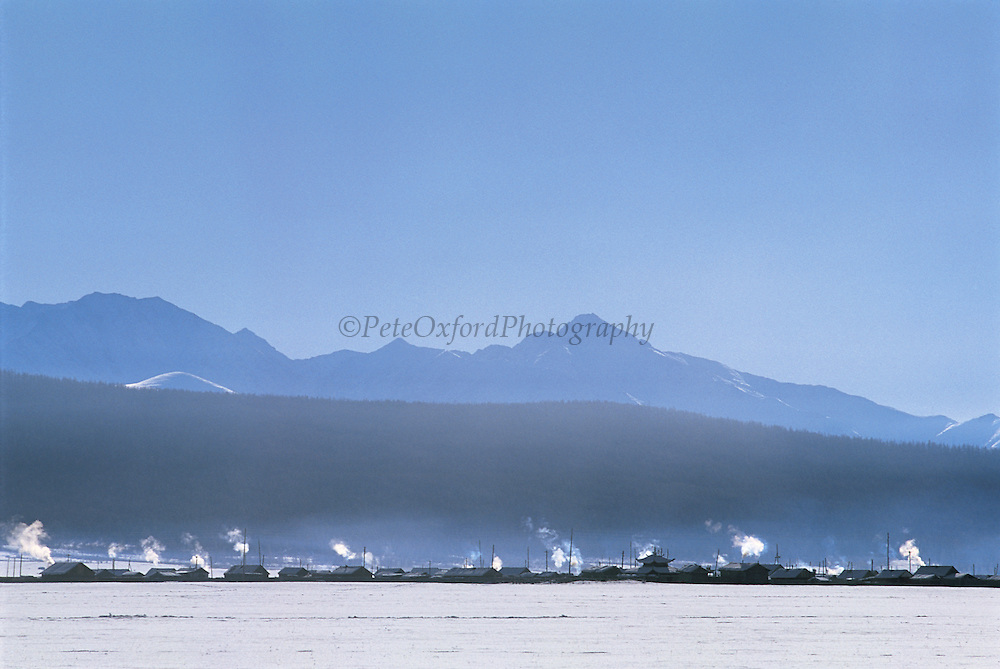 Smoke from Gers & log cabins<br /> near Renchihlhumbe Town<br /> Darkhadyn Khotgor Depression<br /> Northern Mongolia