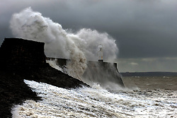 © Licensed to London News Pictures. 25/08/2020. Porthcawl, Bridgend, Wales, UK. Storm Francis batters the small Welsh seaside resort of Porthcawl in Bridgend, UK. with gale force winds and massive waves. Photo credit: Graham M. Lawrence/LNP