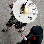 Ascot June 17th  A  lady wearing a working Sundial hat walks into Ascot Racxecourse on the second day of Royal Ascot 2009...***Standard Licence  Fee's Apply To All Image Use***.Marco Secchi /Xianpix. tel +44 (0) 845 050 6211. e-mail ms@msecchi.com or sales@xianpix.com.www.marcosecchi.com