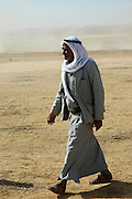 Israel, Negev Desert, Bedouin man in traditional dress. Full body