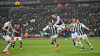 Football - 2016 / 2017 Premier League - West Ham United vs. West Bromwich Albion<br /> <br /> Jonathan Calleri of West Ham forces his way into a gap to head between  two West Brom defenders at the London Stadium.<br /> <br /> COLORSPORT/DANIEL BEARHAM