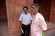 Brij Khandelwal, a renown environmental journalist for the Times of India, is stading with R.K. Dixit, the senior government conservator at the Taj Mahal  complex in Agra.