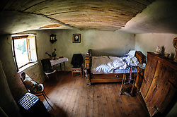 Interior of a troglodyte dwelling in the village of Graufthal, Alsace, France.  The houses are built into the cliffs with the rock forming the ceiling and floor.  Dating back several centuries, the houses were inhabited until 1958 and are now a historical monument.<br /> <br /> (c) Andrew Wilson   Edinburgh Elite media