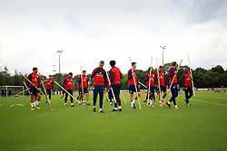 3 September 2017 -  2018 FIFA World Cup Qualifying (Group F) - England Training - The England squad go through a series of stretching exercises involving wooden sticks - Photo: Marc Atkins/Offside