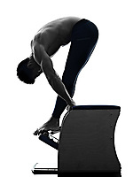 one caucasian man exercising pilates chair exercises fitness in silhouette isolated on white backgound