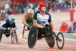 © London News Pictures. 04/09.2012. Olympic Stadium, Stratford, London. ParalympicsGB Dave Weir celebrates crossing the finish line and winning gold in the Men's 1500m T54 race.  Picture credit should read Manu Palomeque/LNP