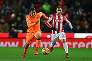 Roberto Firmino of Liverpool (l) and Xherdan Shaqiri of Stoke City chase the ball. Premier league match, Stoke City v Liverpool at the Bet365 Stadium in Stoke on Trent, Staffs on Wednesday 29th November 2017.<br /> pic by Chris Stading, Andrew Orchard sports photography.