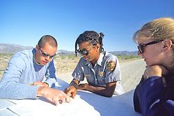 Brent, Gillian & Marina Looking At Maps