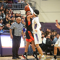 Gallup Bengal Isaac Bustinza (21) looks to pass as he is fouled by Miyamura Patriot Isiah Begay (23) Friday night at Miyamura High School in Gallup. Gallup took the win 76-46.