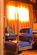 Inside hair saloon with blue chair and window, Havana, Cuba