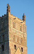 """Exterior of south facing facade of Tewkesbury tower Abbey  dating from 1150  rated """"probably the largest and finest Romanesque tower in England"""" by Sir Nikolaus Pevsner."""