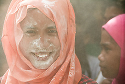 September 12, 2016 - Philippines - A young girl smiles through a cloud of flour after playing a traditional Filipino game at the Blue Mosque in Taguig, Metro Manila. Filipino-Muslims celebrated Eid Al-Adha early Monday morning with prayers and games at the Blue Mosque in Taguig, Metro Manila. (Credit Image: © J Gerard Seguia via ZUMA Wire)