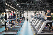 Employees uses the gym during lunch hours at JD.coms headquarters in Beijing, China, on Monday, Nov. 30, 2015.  JD.com is Chinas second largest online retailer and is locked in a fierce battle with rival Alibaba.