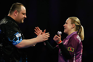 Anastasia Dobromyslova congratulates Ryan Joyce during the World Championship Darts 2018 at Alexandra Palace, London, United Kingdom on 17 December 2018.