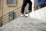 low angle view of people walking up the stairs