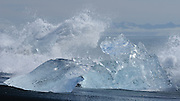 Stranded icebergs are pounded by waves at Jökulsárlón, Iceland