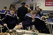 Kronstadt, Russia, 21/02/2004..11 year old Ivan Mishukov is a student at the Naval Kadetskii Korpus, the school of the elite Kronstadt Naval Academy. Abandoned by his alcoholic parents at the age of 3, Ivan lived for 2 years with a pack of wild dogs in his home town of Reutov before being rescued by police and taken to a children's home; he was subsequently adopted by Tatiana Bababina..Ivan in the school canteen at lunchtime.