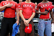 Left to right, Jake Tucker of Fort Worth, D.J. McLaughlin of Plano and Josh Polak of Waxahachie stand proudly wearing painted-on jerseys of their favorite players during the National Anthem before the Texas Rangers' game against the Minnesota Twins at Rangers Ballpark in Arlington August 25, 2010.