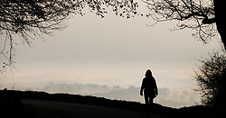 © Licensed to London News Pictures. 22/11/2018. Dorking, UK. A walker looks out from Box Hill near Dorking, as mist and frost cover the valley below. Photo credit: Peter Macdiarmid/LNP