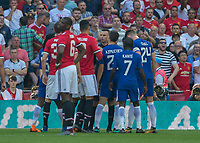 Football - 2018 FA Cup Final - Chelsea vs. Manchester United<br /> <br /> Players surround Referee Michael Oliver to apply pressure to a decision at Wembley Stadium.<br /> <br /> COLORSPORT/DANIEL BEARHAM