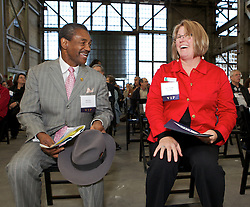 Vallejo Mayor Osby Davis, and City Council member Erin Hannigan laugh as Blu Homes opens their West Coast factory on Mare Island in Vallejo, California Dec. 1, 2011.  Over 400 guests attended a ribbon cutting ceremony at the 250,000-square-foot facility.