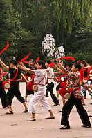 Banner Dance and Drums at Renmin Park or Peoples Park in Chengdu serves as a kind of exercise as well as a get-together for local women wanting some organized activity along with their exercise.