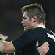 Richie McCaw embraces Andy Ellis, New Zealand, after the final whistle during the New Zealand V France Final at the IRB Rugby World Cup tournament, Eden Park, Auckland, New Zealand. 23rd October 2011. Photo Tim Clayton...
